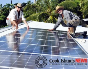 Mary Smith and 'Solar' Bob Riley installing a donated solar system at the Esther Honey Foundation's Rarotonga animal clinic.