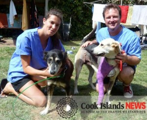 Esther Honey's practice manager Carl Hartnett with volunteer from Italy Martina Majavacchi – who has been at the clinic for two and a half months – and dogs Flora (left) and Candy.